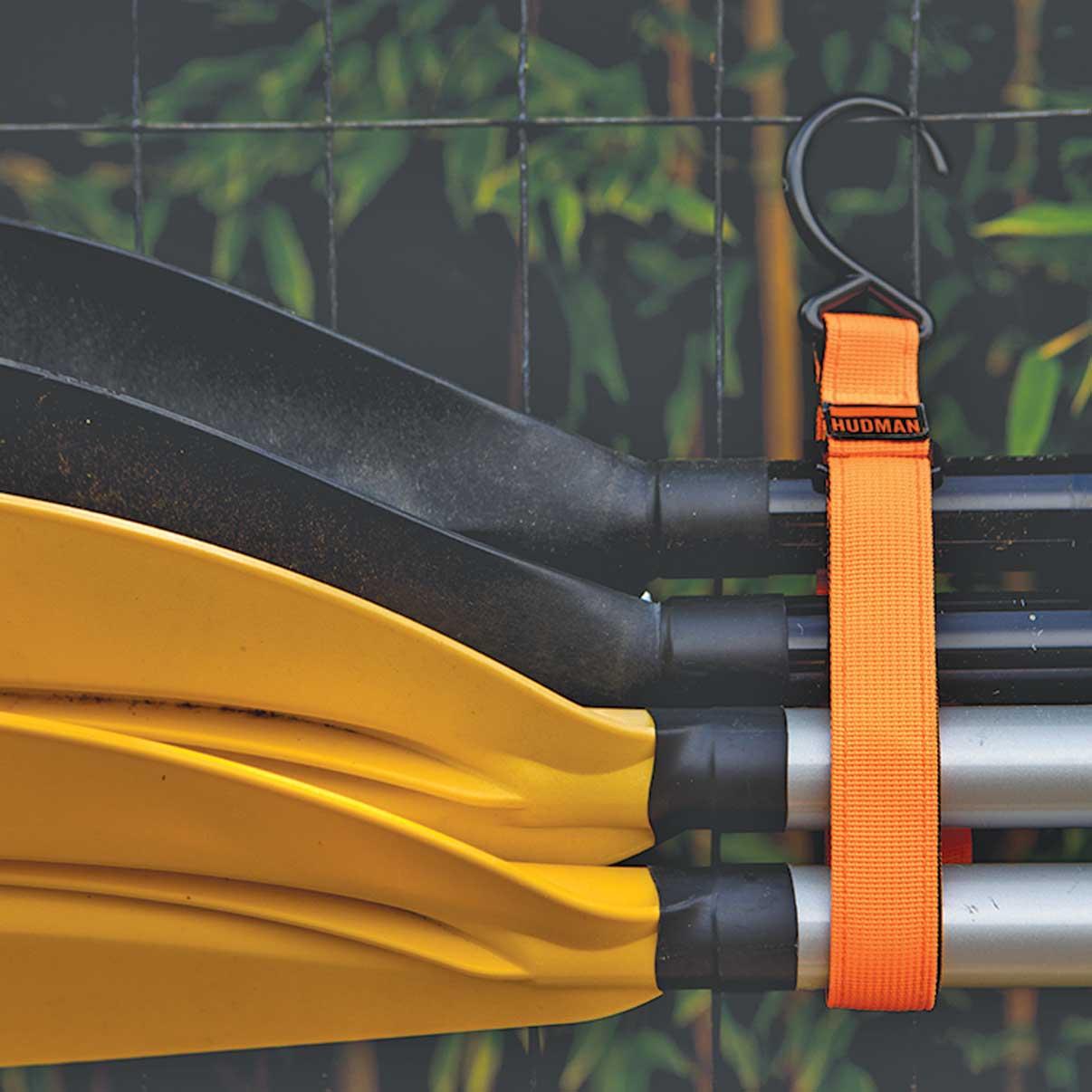 Use the Hudman Strap & Hook to hang oars & paddles